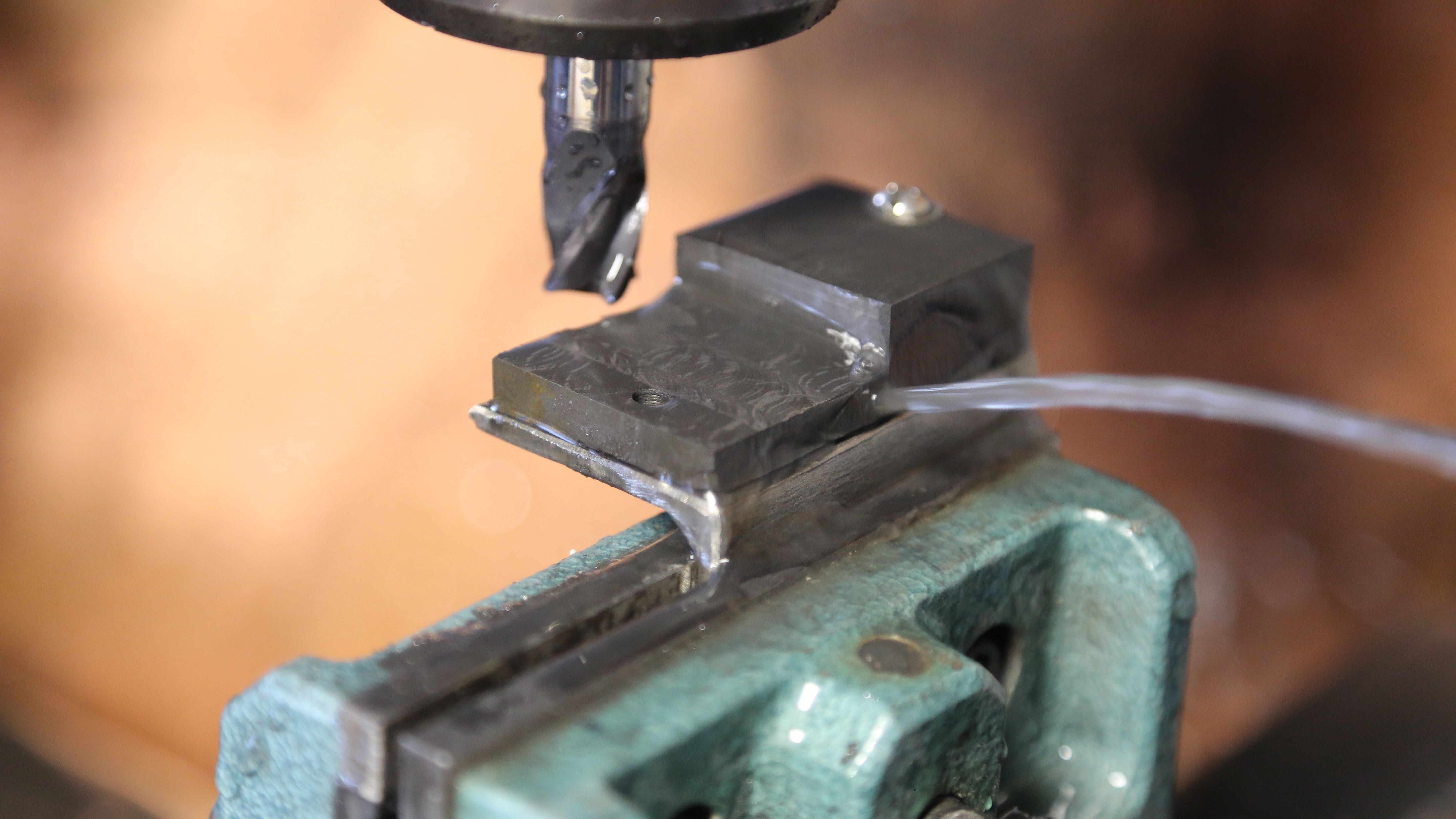 "Machining the graphite block. Graphite works at high temperatures and is nice and soft (its essentially pencil ""lead"")"